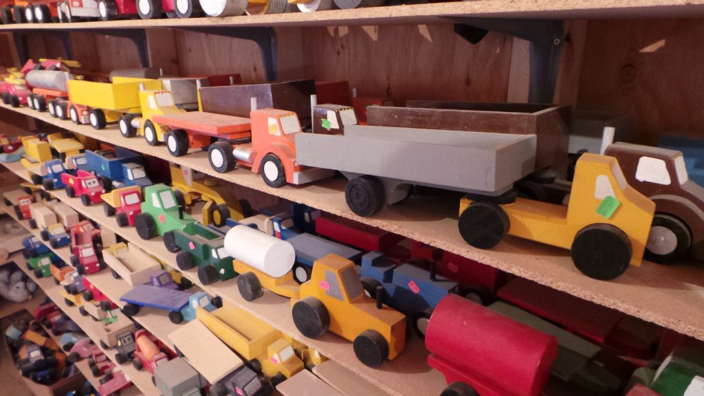 Assortment of various painted, wooden vehicles