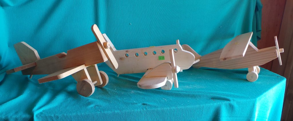 Image of 3 different types of wood model planes (with propellers)
